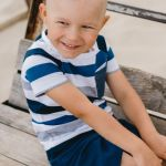 Summer outfit set with blue shorts and striped T-shirt for kids, toddler, boy.