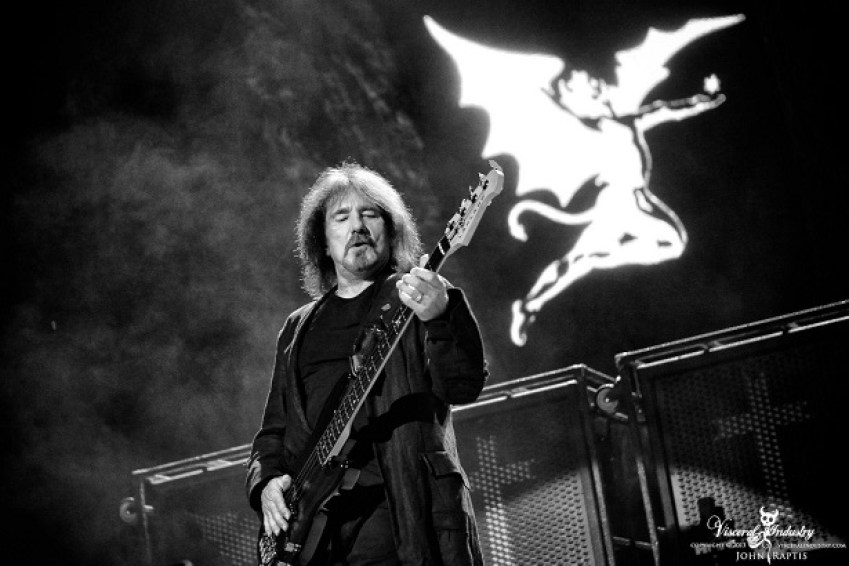Geezer Butler playing bass