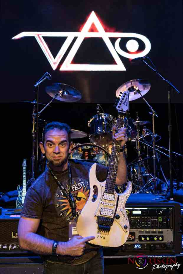 With Steve's iconic EVO guitar