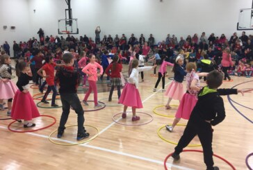 Elementary students strut their stuff for a new playground