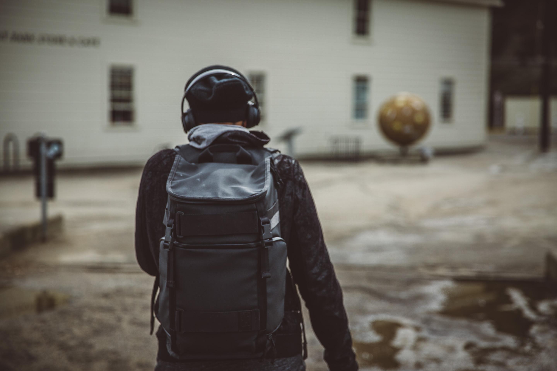 guy walking with headphones