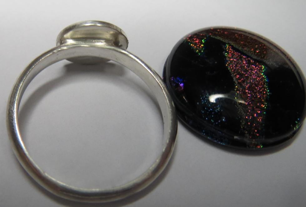 Sterling Silver Ring with silver round shape soldered incorrectly