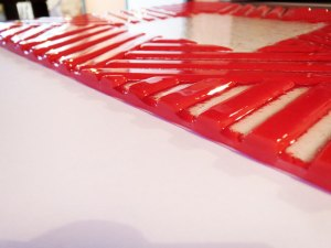 Ground edges of fused glass