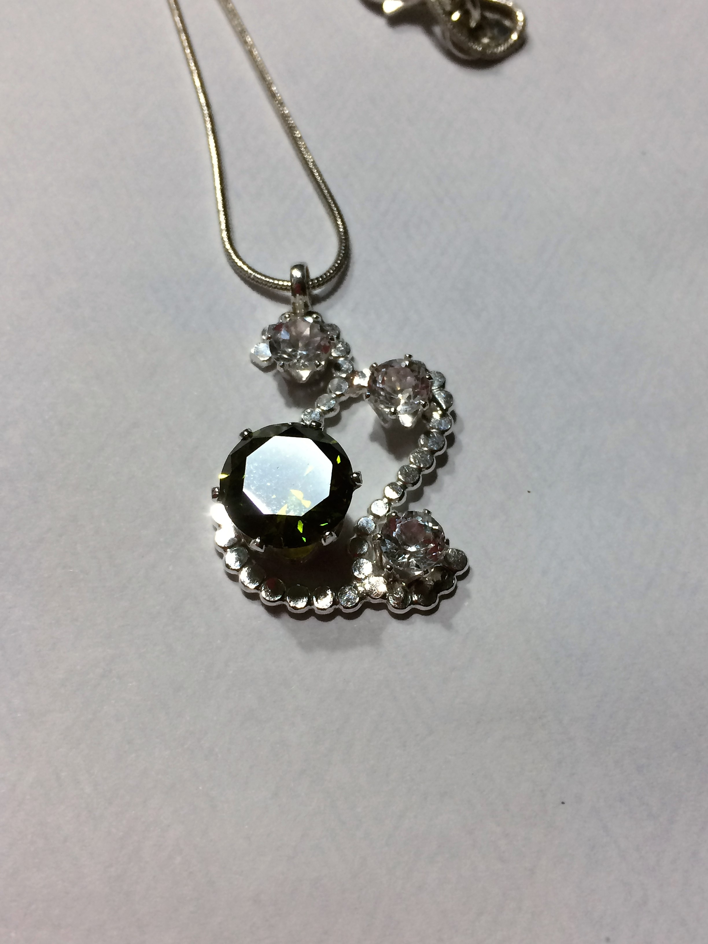 Turning A 6.45ct Olive Green Zircon Into A Pendant