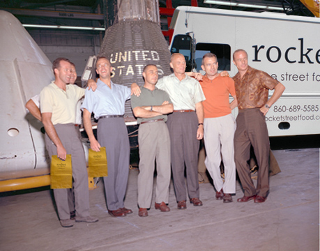 Mercury Seven with rocket and bags