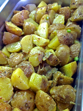 Lyonnaise Potato Salad: Local Butterball Potatoes, Olive Oli, White Wine Vinegar, White Wine, Coarse Mustard, Garlic ScapesCoarse Mustard