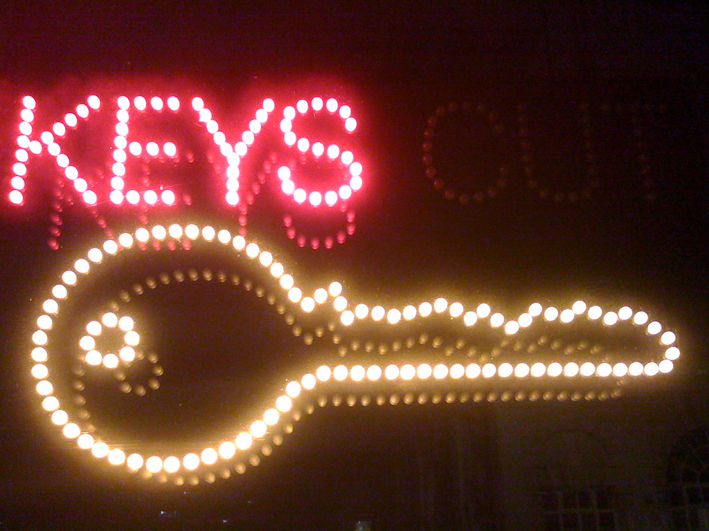 neon sign that says keys and has an outline of a key