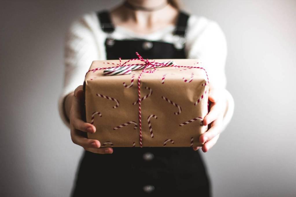 girl giving a gift