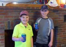 Grady and Cooper wearing hats and drinking cool sodas