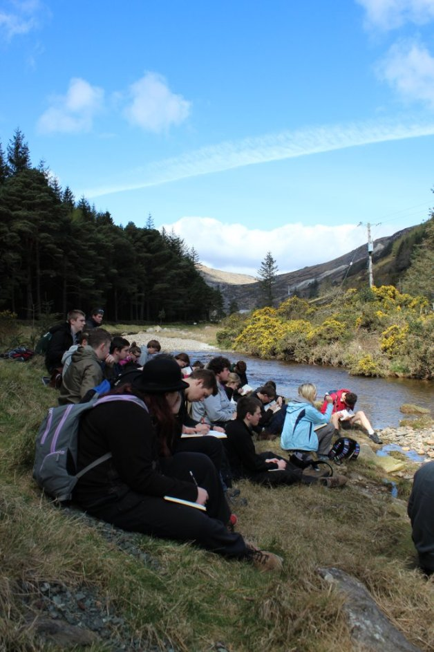 Undergraduate students discussing fluvial geomorphology in the Wicklow Mountains. Copyright 2014 Tom Holt