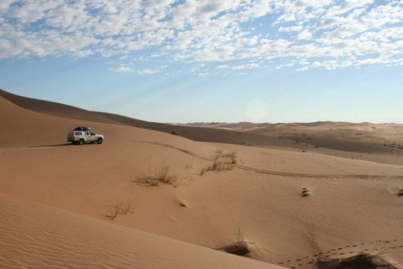 On the Namib desert highway, heading into the sand sea. Copyright: Abi Stone