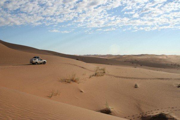 On the Namib desert highway, heading into the sand sea. Copyright: Abi Stone