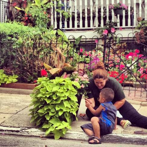 Aine and Jamir tending our flower pot.