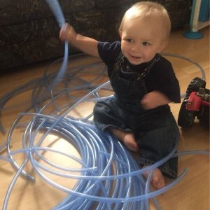 Baby Playing With Maple Sugar Tubing