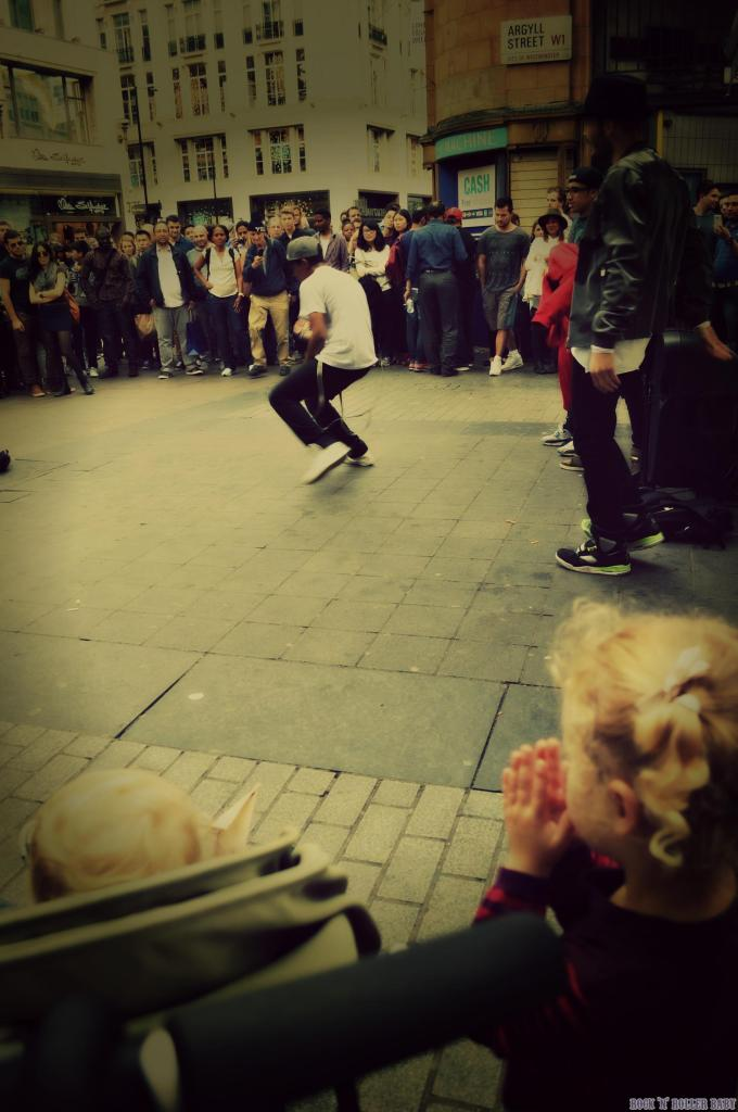 Watching break dancers on Argyll Street!