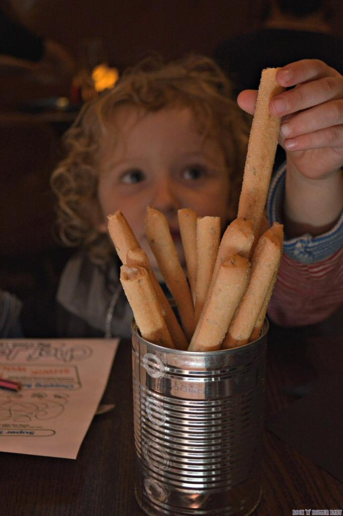 Tucking into the bread sticks pre-meal!