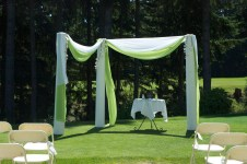 We draped white and green chiffon between our columns. For the most part it was great but when the wind picked up it caused the columns to shift in an uncomfortable way. We ended up cutting slits in the fabric parallel to the ground to let the wind through more easily.