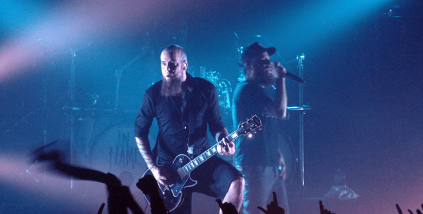 Bjorn from In Flames shredding on stage during Defenders Of The Faith at Brixton Academy
