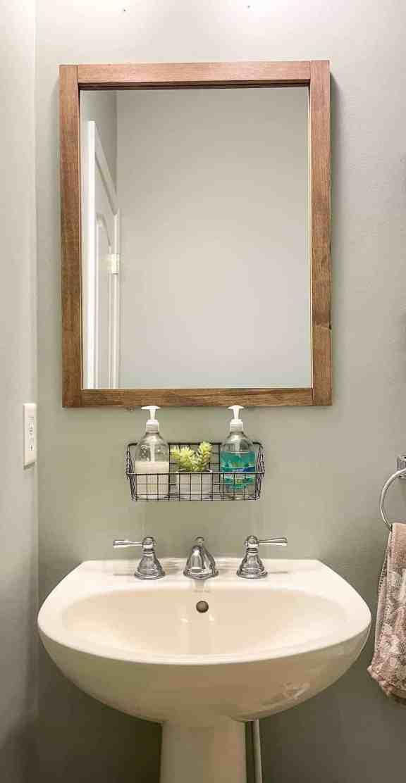 How to Make a Frame, mirror frame, easy diy mirror frame, stick on frames for bathroom mirrors, mirror frame, frames for mirrors