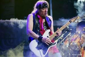 Iron Maiden guitarist Adrian Smith - Photo by Tom Collins