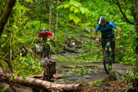 Mike Thomas and Alex Dawson climbing the three bridges section of Rocky Knob Bike Park