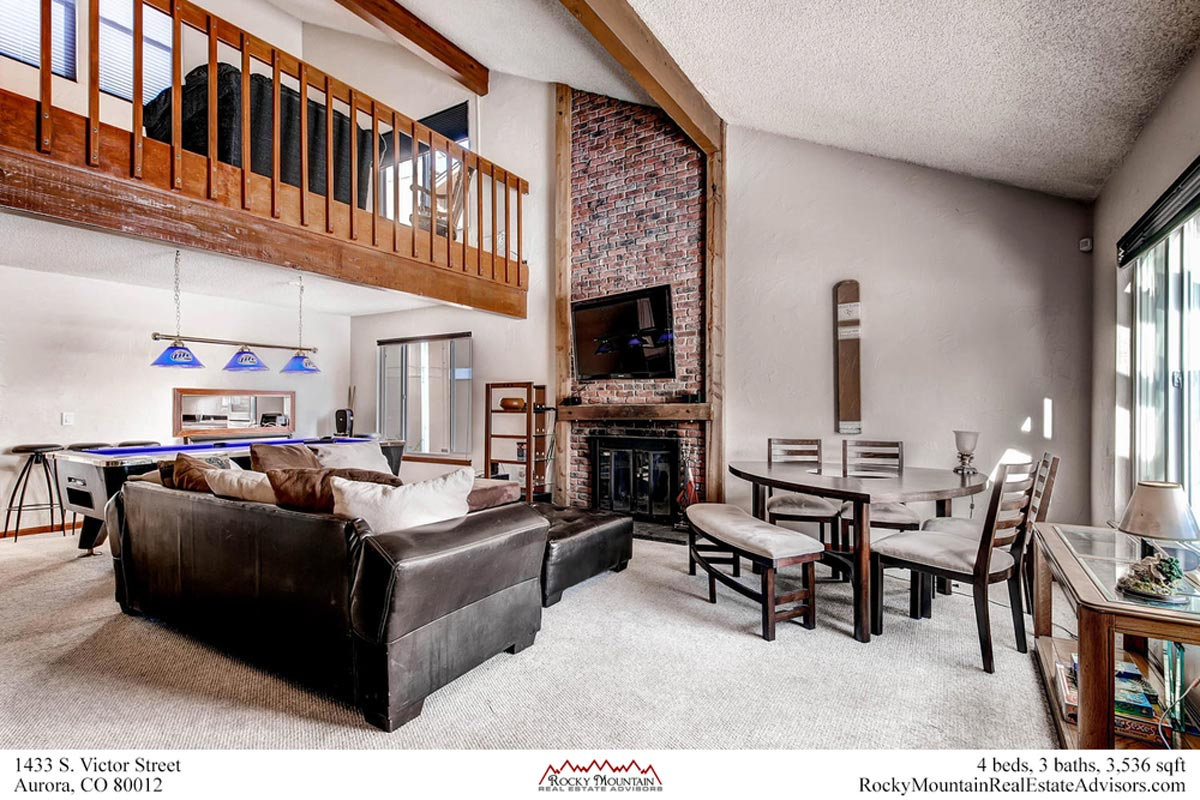Two story fireplace and family room in this aurora home for sale