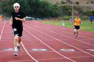 Alan Mindell running in the senior games.