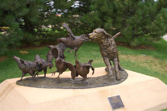 """""""City Dog,"""" a statue in Colorado dedicated to hunters who heed the voices."""