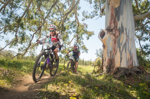 Two strong female athletes: Wendy Stevenson (4H winner) and Catherine Woold (7H winner) entering a shady section on a hot spring race day.