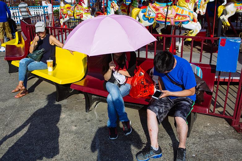 fotos callejeras en luna park coney island