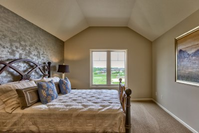 El Dorado secondary bedroom with vaulted ceiling