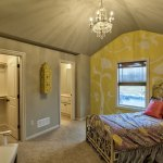 Lancaster III secondary bedroom with yellow wallpaper