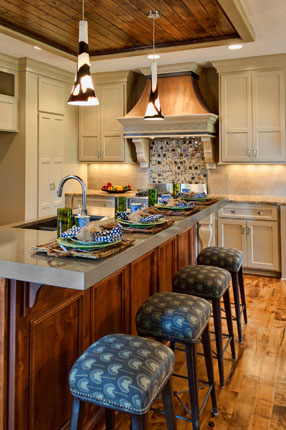 Copper vent hood in Kitchen of larsen II model home for Rodrock homes.