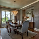Custom built home dining room with silver wallpaper