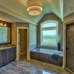 Roanoke master bath with stained cabinets