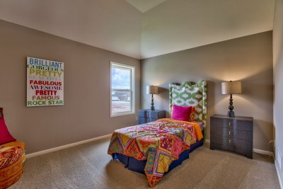 Somerset secondary bedroom with colorful bedspread