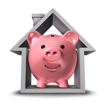 Safe and Secure real estate services with a pink ceramic piggy bank in a house structure symbol. Representing the highest housing industry services standards for real estate buying and selling strategies or rental property leasing and letting.