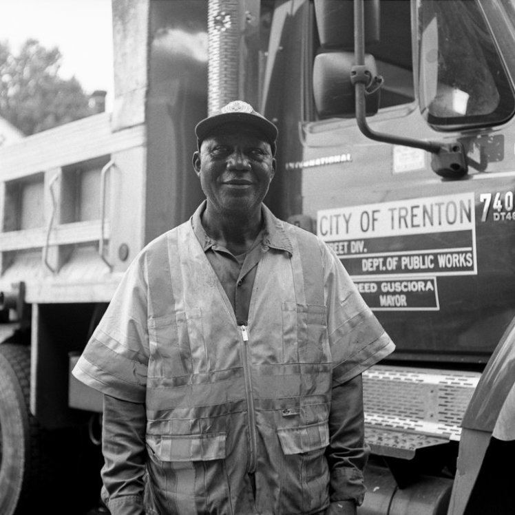 A Trenton City worker poses for a portrait in the Wilbur section. Under Mayor Reed's administration many have been instructed to clean up abandoned lots often filled with illegal dumping and trash.