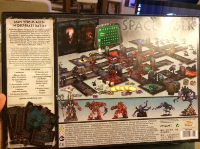 The back of the box shows an example game, 'eavy Metal painted minis and the contents.
