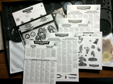 The minis each get their own manuals. With the various parts in all the sprues, this is a very welcome addition.