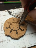 """Then plucked the cork with pliers tracing the shape to have the design etched to the """"stone""""."""