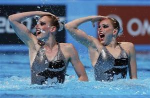 Russia's Svetlana Kolesnichenko and Svetlana Romashina perform in the synchronised swimming duet technical routine final during the World Swimming Championships at the Sant Jordi arena in Barcelona July 21, 2013. REUTERS/Albert Gea