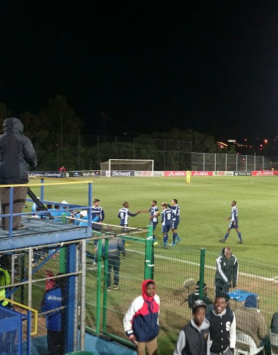GOAL!: Bidvest Wits after they scored their second of three goals. You could just feel their happiness as sprung across the field for what seemed like an eternity before the game continued under the black sky. They won the game
