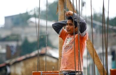 Young man takes a rest while working in a construction site. L'Oreal Yapanegui center for women, Temoaya, Estado de México