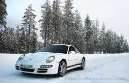 Porsche Camp4, winter driving school, 997 Porsche 911 Carrera 4S in iced road in woods, Rovaniemi, Finland