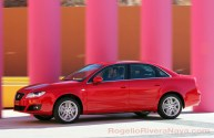 2011 Seat Exeo running shot panning low speed in front of colorful columns, Los Cabos, Baja California, Mexico