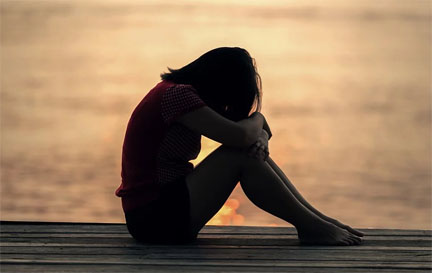 Girl grieving on dock