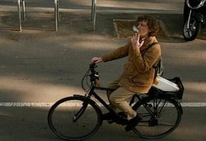 Image of smoker on a bicycle