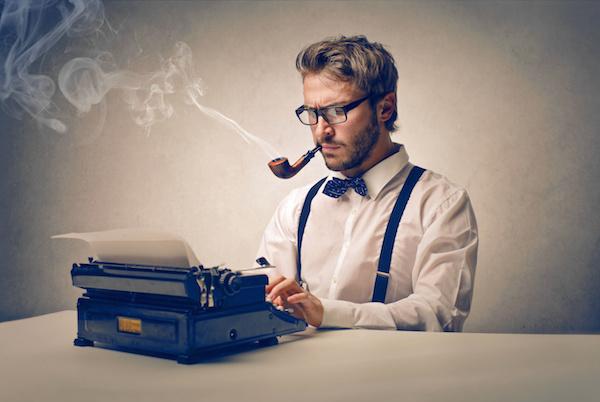 image of man at typewrite smoking a pipe