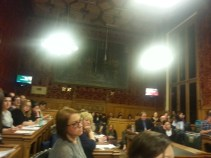 Filling every seat of the committee room.